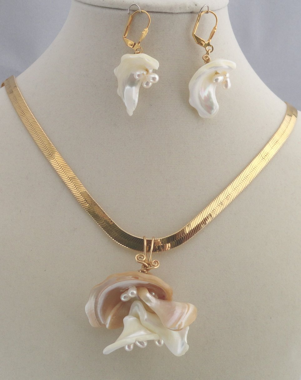 Flowers From The Sea, Large pendant (without chair) $40, Earrings $25 Created from Mother of Pearl Free Form Pieces and small natural pearls with non-tarnish brass jewelers wire.