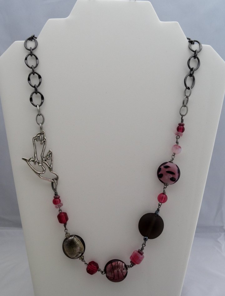 Bird In Flight captures the viewer with the combination of handmade lampwork beads, chain and crystals beads. $40