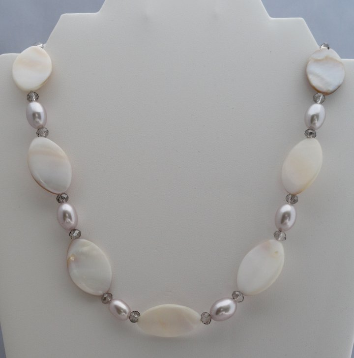 Oval Natural Mother of Pearl with crystals. $ 35